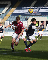 13th March 2021; Dens Park, Dundee, Scotland; Scottish Championship Football, Dundee FC versus Arbroath; Declan McDaid of Dundee challenges for the ball with Jason Thomson of Arbroath