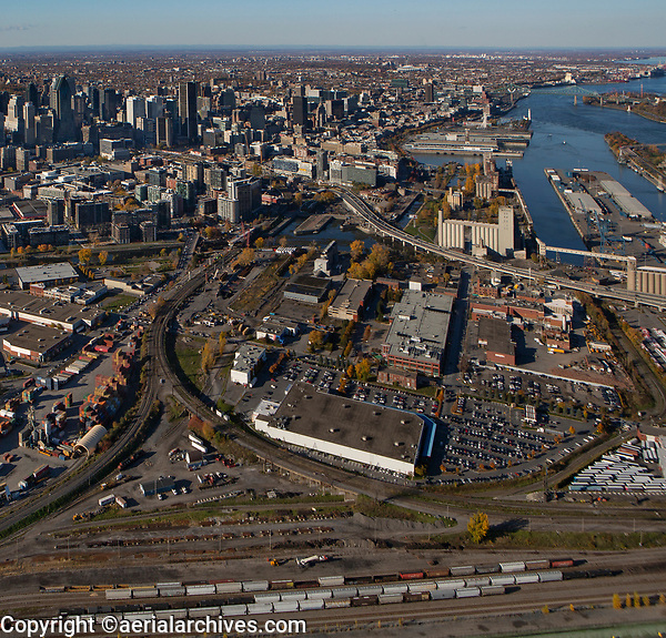 aerial photograph of Cite du Havre, Montreal, Quebec, Canada in the fall. Costco warehouse in the foreground, financial district left, Saint Lawrence River right | photographie aérienne de la Cité du Havre, Montréal, Québec, Canada à l'automne.