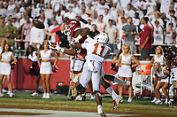 Arkansas wide receiver Treylon Burks (16) reaches for a pass, Saturday, September 11, 2021 during the third quarter of a football game at Reynolds Razorback Stadium in Fayetteville. Check out nwaonline.com/210912Daily/ for today's photo gallery. <br /> (NWA Democrat-Gazette/Charlie Kaijo)