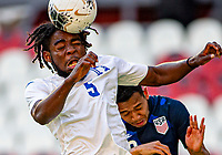 GUADALAJARA, MEXICO - MARCH 28: Christopher Melendez #5 of Honduras heads a ball past Sebastian Saucedo #10  of the United States during a game between Honduras and USMNT U-23 at Estadio Jalisco on March 28, 2021 in Guadalajara, Mexico.