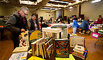 BEACON FALLS, CT - 05 NOVEMBER 2016 - 110516JW04.jpg --Glenn and Donna Murphy of Oxford browse some books while shopping at the Friends of Beacon Falls Library Holiday Shopping Fair Saturday morning at St. Michaels Roman Catholic Church.    Jonathan Wilcox Republican-American