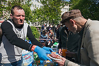 Moscow, Russia, 15/05/2012..A protester with hands out food at a makeshift kitchen in Chistiye Prudy, or Clean Ponds, as a Moscow court ordered the eviction of some 200 opposition activists who have set up camp in the city centre park.