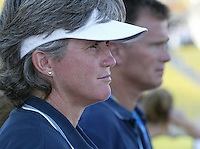 23 August 2004:   USA Women's Head Coach April Heinrichs watches her team line-up on the field before the game against Germany during the semifinal game at Pankritio Stadium in Heraklio, Greece.     USA defeated Germany, 2-1 in overtime.   Credit: Michael Pimentel / ISI