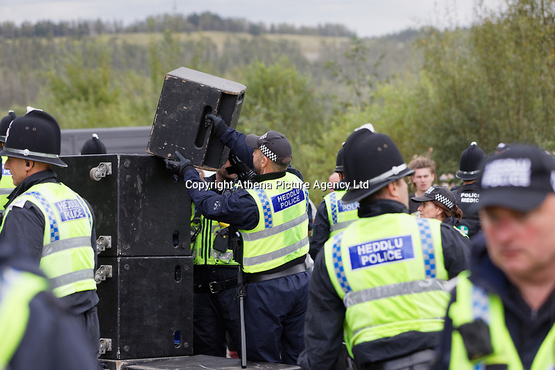 Pictured: Police officers move away sound gear which they confiscated. Monday 31 August 2020<br /> Re: Around 70 South Wales Police officers executed a dispersal order at the site of an illegal rave party, where they confiscated sound gear used by the organisers in woods near the village of Banwen, in south Wales, UK.