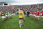 A dejected Dermot Coughlan, Clare captain ;eaves the field with boots in hand following their Minor Munster final loss against Kerry at Killarney.  Photograph by John Kelly.