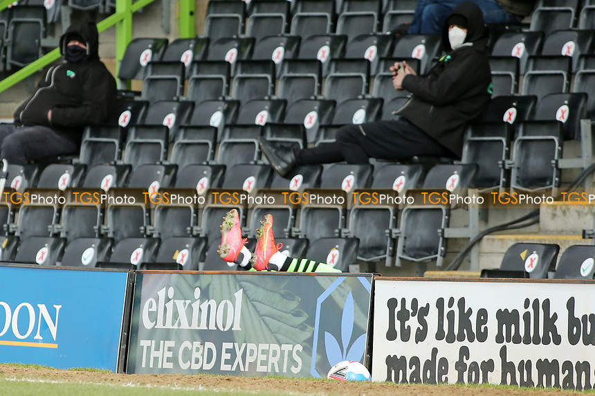 Forest Green Rovers's Udoka Godwin-Malife  ends up in the stand during Forest Green Rovers vs Bolton Wanderers, Sky Bet EFL League 2 Football at The New Lawn on 27th March 2021