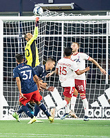 FOXBOROUGH, MA - JUNE 26: Earl Edwards Jr. #90 of the New England Revolution punches the ball away on a corner kick during a game between North Texas SC and New England Revolution II at Gillette Stadium on June 26, 2021 in Foxborough, Massachusetts.