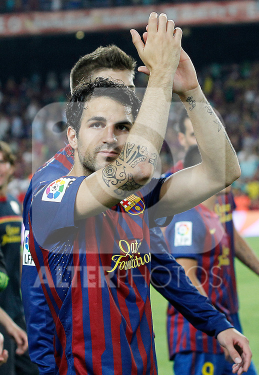 FC Barcelona's Cesc Fabregas celebrate the victory during Spanish Supercup 2nd match.August 17,2011. (ALTERPHOTOS/Acero)