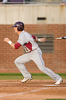 Cory Harrilchak #2 of the Elon Phoenix follows through on his swing versus the East Carolina Pirates at Clark-LeClair Stadium March 29, 2009 in Greenville, North Carolina. (Photo by Brian Westerholt / Four Seam Images)