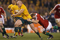 MELBOURNE, 29 JUNE 2013 - Stephen MOORE of the Wallabies is tackled by Tom CROFT of the Lions during the Second Test match between the Australian Wallabies and the British & Irish Lions at Etihad Stadium on 29 June 2013 in Melbourne, Australia. (Photo Sydney Low / sydlow.com)