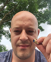 BNPS.co.uk (01202 558833)<br /> Pic: MarkThompson/BNPS<br /> <br /> Mark Thompson, just after finding the ring.<br /> <br /> A medieval ring found by a metal detectorist in the heart of Robin Hood's Sherwood Forest is tipped to sell for £50,000.<br /> <br /> Mark Thompson unearthed the gold ring in the Nottinghamshire woodland made famous by the legendary outlaw.<br /> <br /> The ring that contains a sapphire gemstone would have belonged to someone in the upper echelons of society in 15th century Sherwood.<br /> <br /> It is the sort of bling Robin Hood would have taken from the rich to give to the poor.