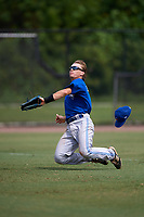 Toronto Blue Jays left fielder Reilly Johnson (7) loses his hat while attempting to make a play on a fly ball during an Instructional League game against the Philadelphia Phillies on September 30, 2017 at the Carpenter Complex in Clearwater, Florida.  (Mike Janes/Four Seam Images)