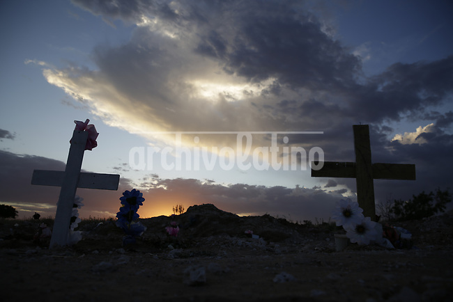 Sun sets over the pits  of a  Covid 19 pandemic victims in the cementery of  Ciudad Juarez, on the Mexican border with the USA. Amidst the never ending violence of this city, corona virus is taking a high death toll.