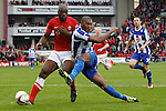Barnsley v Sheffield Wednesday<br /> 26.10.2013<br /> Sky Bet Championship<br /> Picture Shaun Flannery/Trevor Smith Photography<br /> Wednesday's Reda Johnson gets in a shot under pressure from Barnsley's Jean-Yves M'voto