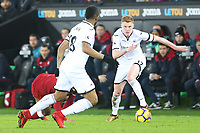 Sam Clucas of Swansea City moves forward with Jordan Ayew during the Premier League match between Swansea City and Liverpool at the Liberty Stadium, Swansea, Wales, UK. Monday 22 January 2018