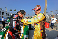 4 July, 2009, Daytona Beach, Florida USA.Scott Speed (L) gets some help with his firesuit from teammate Kyle Busch..©2009 F.Peirce Williams, USA. .