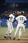 NEW YORK - OCTOBER 18:  Reggie Jackson of the New York Yankees celebrates with Thurman Munson #15 after hitting his third home run during the 1977 World Series game 6 against the Los Angeles Dodgers at Yankee Stadium on October 18, 1977 in Bronx, New York.  The Yankees defeated the Dodgers 8-4. (Photo by Rich Pilling)