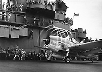 """Dynamic static.  The motion of its props causes an """"aura"""" to form around this F6F on USS YORKTOWN.  Rapid change of pressure and drop in temperature create condensation.  Rotating with blades, halo moves aft, giving depth and perspective.  November 1943.  (Navy)<br /> Exact Date Shot Unknown<br /> NARA FILE #:  0080-G-204747A<br /> WAR & CONFLICT BOOK #:  961"""