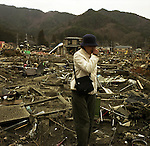 """Mrs. Sasaki finally finds her daughter's wrecked car and approaches to the car in Otsuchi, Iwate, in one month after the earthquake and tsunami. Her daughter's body was already found on May 16, six days after the tsunami, about 300 meters away from the car. Mrs. Sasaki was looking for her daughter's car everyday. When the earthquake hit the area, Mrs. Sasaki's daughter was driving back to her house in Otsuchi from a business meeting in the next town, Ofunato. But, the road was jammed with the panicked drivers. The tsunami washed away all stuck cars. """"I cannot stop crying everyday,"""" said Mrs. Sasaki. """"Her death made a big hole in my heart.""""<br /> <br /> On March 11, 2011, the earthquake of magnitude 9.0, the biggest earthquake in the history of Japan and the fourth biggest earthquake in the world after year 1900, shocked the Tohoku area of Japan. In about 30 minutes, devastating tsunami reached, affecting the coastline with a length of 500 km (310 miles). The tsunami wave height of 39 meters (128 feet) was recorded in a port town in Tohoku. The tsunami swallowed villages along the coast and washed away all houses. The earthquake and tsunami killed more than 15,800 people, and still more than 3,500 people are missing."""