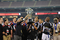 President of the United States Soccer Federation Sunil Gulati presents the US Open Cup Trophy to DC United forward Jaime Moreno, DC United defeated The Charleston Battery 2-1 to win the US Open Cup, Wednesday September 3, 2008 at RFK Stadium.