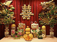 Ceramic cats,dragons,vases and fresh fruits signify prosperity,family unity and good fortune. Here on display in the Golden Palace chinese restaurant in Chinatown, downtown Honolulu, Oahu