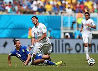 Luis Suarez of Uruguay screams as he is tackled by Leonardo Bonucci of Italy