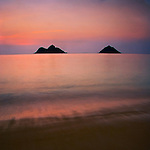 View of Mokulua Islands from Lanikai Beach just before sunrise