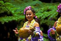 Young hula dancer with ipu (rhythm gourd) and plumeria lei, Lei Day celebration at Hilton Hawaiian Village Hotel