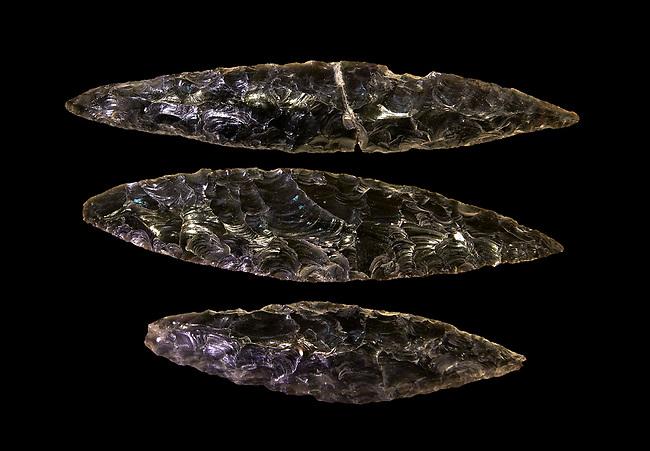 Black obsidian blades. Catalhoyuk Collections. Museum of Anatolian Civilisations, Ankara. Against a black background