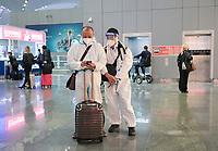 Turkey, Istanbul airport, chinese traveller with protection wear during Corona Pandemic time / TUERKEI, Istanbul Flughafen, Chinesische Reisende in Schutzkleidung während der Corona Pandemie
