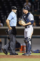 Umpire Ryan Goodman talks with Surprise Saguaros catcher John Hicks (6) during an Arizona Fall League game against the Mesa Solar Sox on October 10, 2014 at Cubs Park in Mesa, Arizona.  Surprise defeated Mesa 14-3.  (Mike Janes/Four Seam Images)