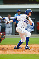 Kevin Kuntz (29) of the Burlington Royals follows through on his swing against the Greeneville Astros at Burlington Athletic Park on July 1, 2013 in Burlington, North Carolina.  The Astros defeated the Royals 7-0 in Game One of a doubleheader.  (Brian Westerholt/Four Seam Images)