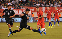 EAST RUTHERFORD, NJ - SEPTEMBER 6: Christian Pulisic #10 of the United States battles for the ball with Jorge Sanchez #21 of Mexico during a game between Mexico and USMNT at MetLife Stadium on September 6, 2019 in East Rutherford, New Jersey.