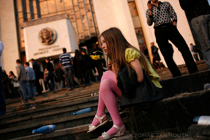 A girl holds flowers on the steps of the damaged presidential building in Chisinau, Moldova on 7 April 2009. Opposition leaders accused the Communists of rigging the elections on 5 April and demanded a recount. Anti-communist rotesters stormed the presidential building, demanding that President Vladimir Voronin announce his resignation and leave Moldova. More than 30 people were injured in the protests.