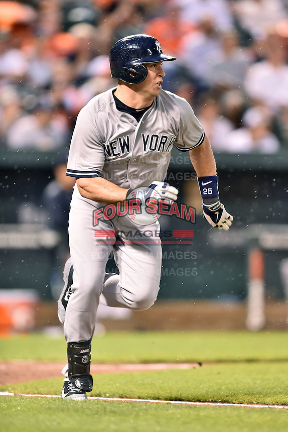 New York Yankees first baseman Mark Teixeira #25 runs to first during a game against the Baltimore Orioles at Oriole Park at Camden Yards August 11, 2014 in Baltimore, Maryland. The Orioles defeated the Yankees 11-3. (Tony Farlow/Four Seam Images)