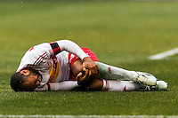 Thierry Henry (14) of the New York Red Bulls grabs his knee in pain. The New York Red Bulls and D. C. United played to a 0-0 tie during a Major League Soccer (MLS) match at Red Bull Arena in Harrison, NJ, on March 16, 2013.