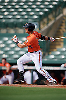 Baltimore Orioles first baseman JC Escarra (72) follows through on a swing during a Florida Instructional League game against the Pittsburgh Pirates on September 22, 2018 at Ed Smith Stadium in Sarasota, Florida.  (Mike Janes/Four Seam Images)