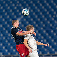FOXBOROUGH, MA - SEPTEMBER 1: Sean O'Hearn #40 of New England Revolution II and Charlie Dennis #10 of FC Tucson battle for head ball during a game between FC Tucson and New England Revolution II at Gillette Stadium on September 1, 2021 in Foxborough, Massachusetts.