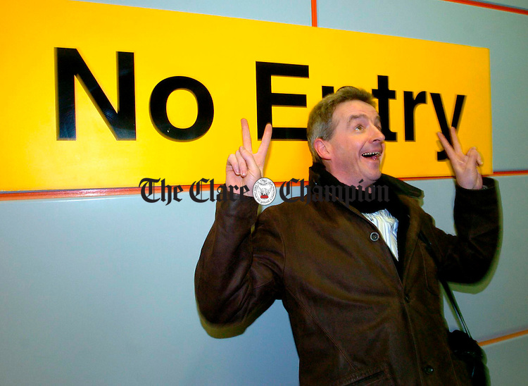 Ryanair CEO Michael O Leary plays to the cameras in Shannon after arriving for the Ryanair press conference. Phtograph by John Kelly.