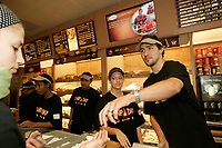 Montreal (Qc) CANADA - file photo- June 2007<br /> Justin Trudeau give a hand for Tim Horton's Camp Day event<br /> <br /> Photo (c)  Images Distribution