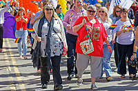 Pictured: Carolyn Harris Labour MP (R) taking part in the Pride parade as it travels through the streets of Swansea, Wales, UK. Saturday 05 May 2018<br /> Re: Spring Pride has brought a celebration of colour to the streets of Swansea in Wales, UK.<br /> Rainbow flags were flown in support of the LGBT community at the event, which is designed to raise awareness and is open to anyone to take part in.