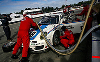 LEXINGTON, OH - SEPTEMBER 17:  The #59 Porsche of Andrew Davis and Leh Keen makes a pit stop during the EMCO Gears Classic at Mid-Ohio Sports Car Course on September 17, 2011 in Lexington, Ohio.  (Photo by Brian Cleary/bcpix.com)