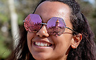 May 1, 2018; The Main Building is reflected in a student's sunglasses. (Photo by Matt Cashore/University of Notre Dame)