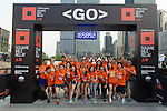 Bloomberg team runners pose for a photograph before the Bloomberg Square Mile Relay near the Huangpu River in Shanghai, China. Photo by Lucas Schifres / Power Sport Images