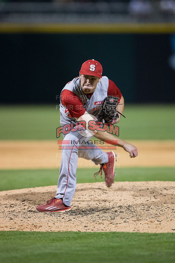 North Carolina State Wolfpack relief pitcher Tommy DeJuneas (42) in action against the Charlotte 49ers at BB&T Ballpark on March 31, 2015 in Charlotte, North Carolina.  The Wolfpack defeated the 49ers 10-6.  (Brian Westerholt/Four Seam Images)