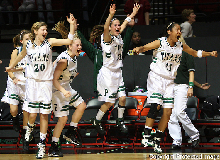 Poway's bench erupts at the final buzzer as they clinch the division championship.  photo for the North County Times