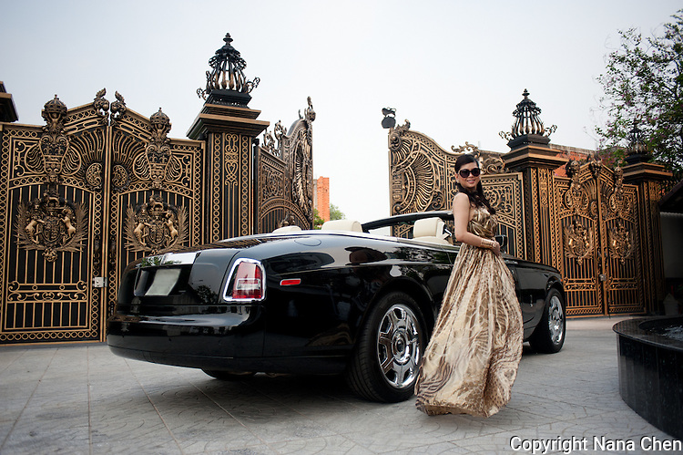 Former film actress and one of Vietnam's wealthiest women, Thuy Tien is the president of Imex Pan Pacific, a trading company that runs over 26 major businesses, including shopping malls, duty free fashion designer boutiques. Pictured here with her Rolls Royce at the entrance of her high security riverside villa in Anphu, Saigon, a residential enclave with rich Vietnamese and expats.