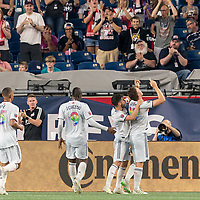 FOXBOROUGH, MA - JUNE 29: Antonio Mlinar Delamea #19 celebrates his goal with teammates during a game between Houston Dynamo and New England Revolution at Gillette Stadium on June 29, 2019 in Foxborough, Massachusetts.