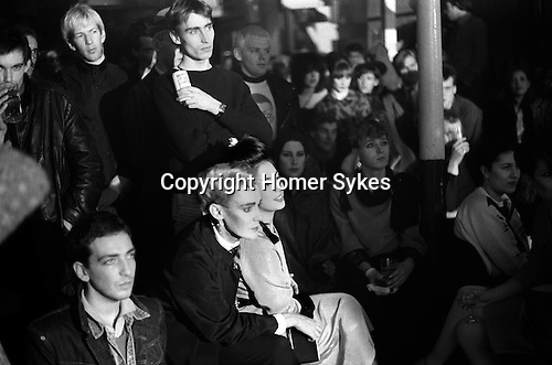 Blitz Club Covent Garden London 1980. <br /> <br /> Stephen Linard with Lesley Chilkes. Blonde guy in background on left, Michael Kostiff<br /> <br /> Johnny Rozsa photographer. Bottom left in denim jacket with eye make-up.