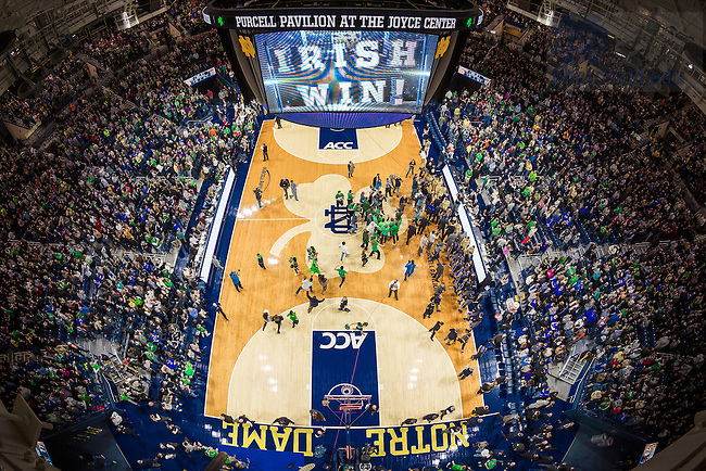 Jan. 4, 2014; Fans rush the court after Notre Dame defeated the Duke Blue Devils 79-77 in the Men's Basketball ACC-opening game.<br /> <br /> Photo by Matt Cashore